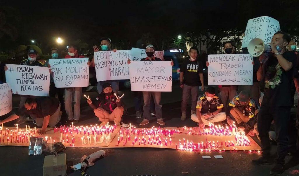 Warga Nyalakan Seribu Lilin di Depan Balaikota Malang, Tuntut Pelanggaran PPKM Sutiaji Diusut Tuntas